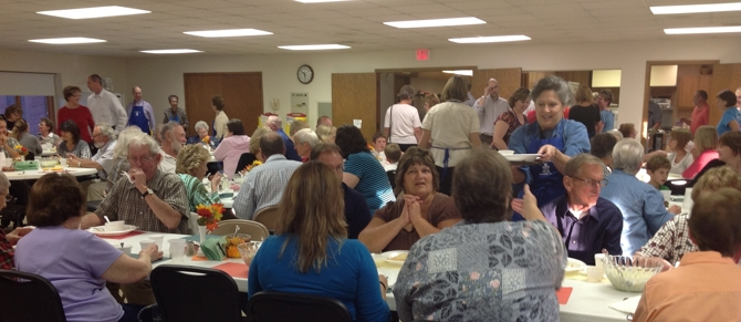Crowd at an event in fellowship hall
